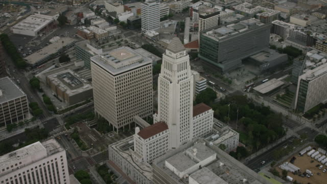 Aerial flying over Downtown Los Angeles City Hall , CA morning