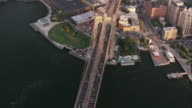 Aerial flying over East River and Brooklyn Bridge into Dumbo Brooklyn, NYC