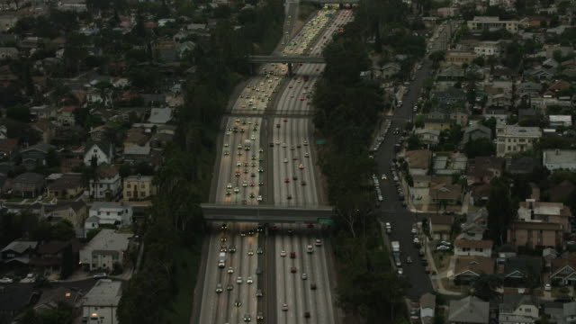 Aerial flying over interstate 10 in Los Angeles CA, sunset