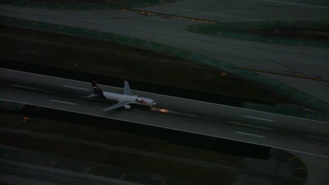 Aerial flying over LAX airport at sunrise, Los Angeles, CA