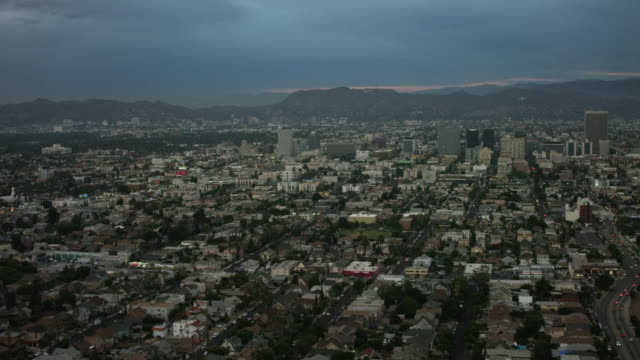 Aerial flying over Los Angeles CA, camera panning over from Hollywood sunset
