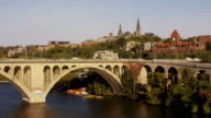 Aerial flying over Potomac River towards Georgetown University DC