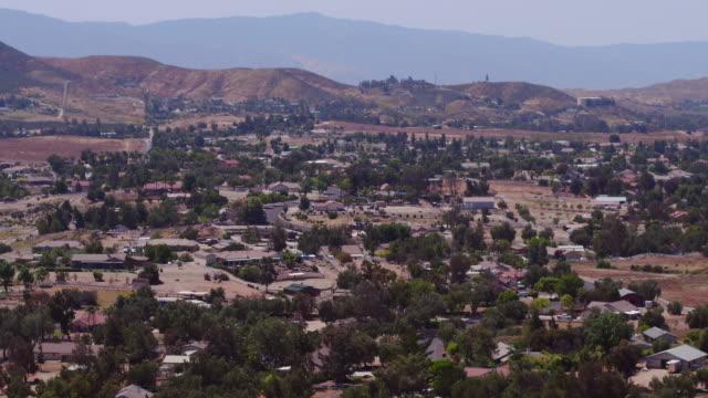 Aerial flying over residential area in the desert, California Daytime