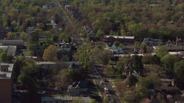 Aerial flying over suburban Philadelphia neighborhood on a sunny spring day
