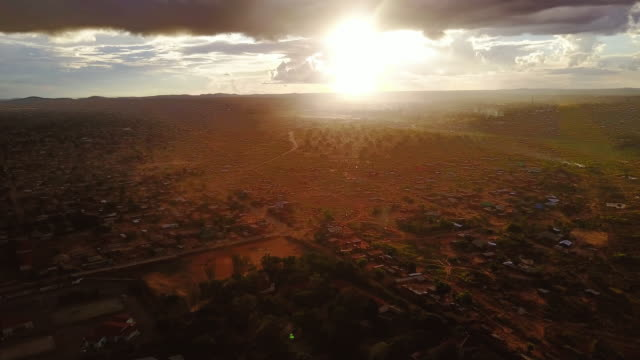 Aerial flying over the city of Lubumbashi, Congo, in Africa at sunset