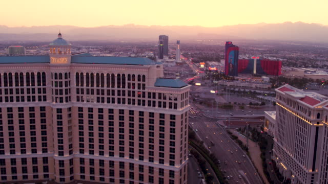 Aerial flying over The Las Vegas Strip past The Bellagio Hotel and Casino, Sunset