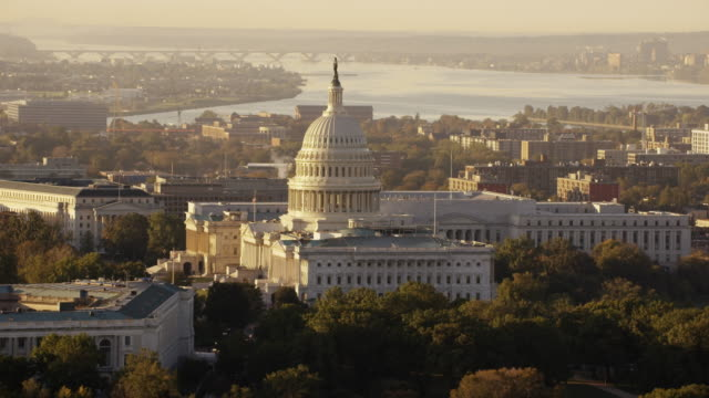 Aerial flying over Washington DC, United States Capitol, sunrise