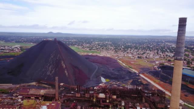 Aerial flying towards copper mine, daytime Lubumbashi, Congo, Africa