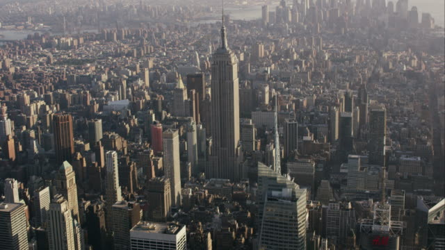 Aerial flying West over midtown Manhattan looking south at Empire State Building