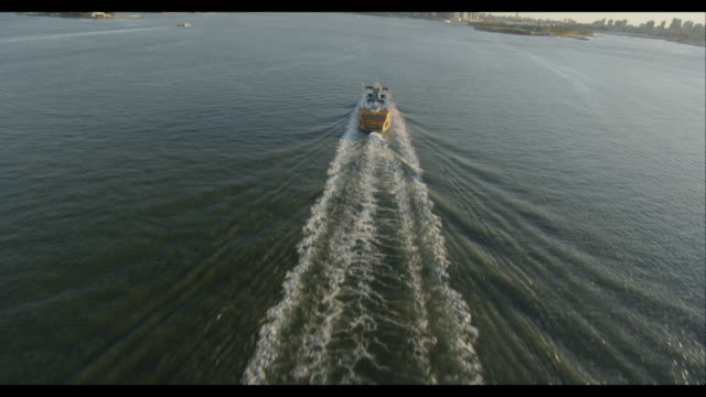 Aerial fly-over Staten Island Ferry to reveal of Downtown Manhattan