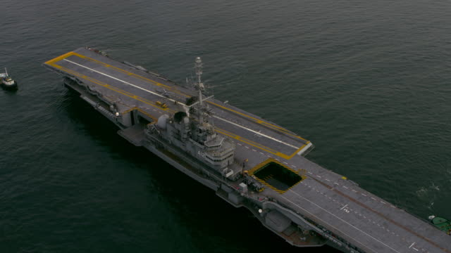 Aerial footage of Aircraft Carrier in Atlantic Ocean.