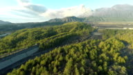 Aerial footage of Sakurajima volcano in Japan erupting volcanic ash into the sky NO