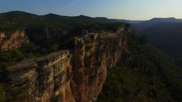 Aerial footage recorded with drone flying over the stunning Siurana town in top of cliff with nice views in the Tarragona mountains during travel vacations.