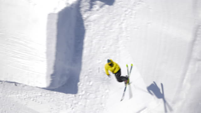 Aerial Freestyle skier performing a spin and grab trick variation