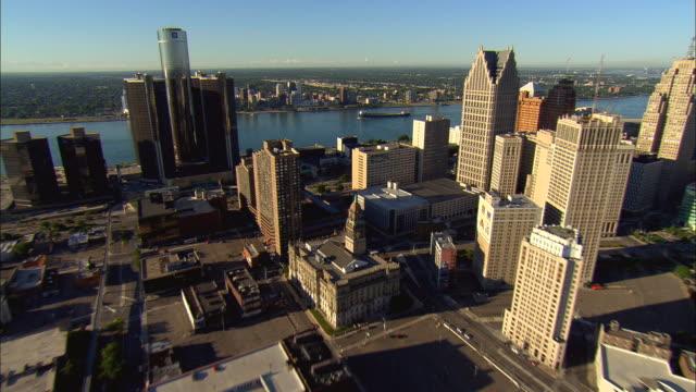 Aerial WS TD General Motors headquarters at Renaissance Center with surrounding downtown buildings along Detroit River / Detroit, Michigan, USA
