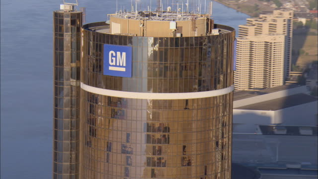 Aerial CU GM sign on General Motors headquarters at Renaissance Center along Detroit River / Detroit, Michigan, USA