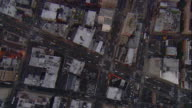 Aerial -Just after sunset, a vertical tracking shot of buildings and traffic in lower Manhattan.