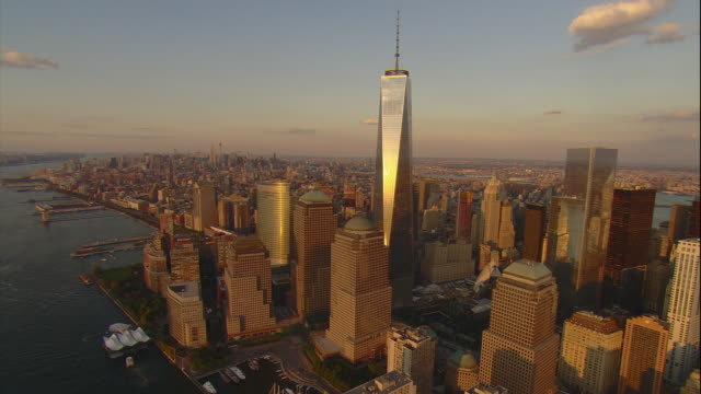 Aerial -Just before sunset, sun reflects off of the Freedom Tower and buildings in Tribeca with slow ZI to buildings in the Hudson Square area of lower west Manhattan.