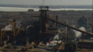 Aerial -Late winter afternoon shot of steel mill in East Chicago, IN, with a ZI to molten steel pouring into slag pit.