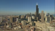 Aerial -Late winter afternoon wide shot of the west side of the Chicago skyline including the Willis Tower.