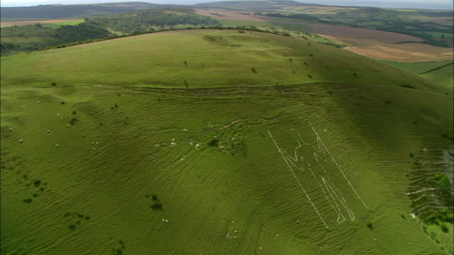 Aerial Long Man of Wilmington chalk carving on Windover Hill in the South Downs / Sussex, England