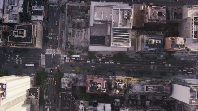 Aerial looking directly down at 57th street and following traffic West, NYC
