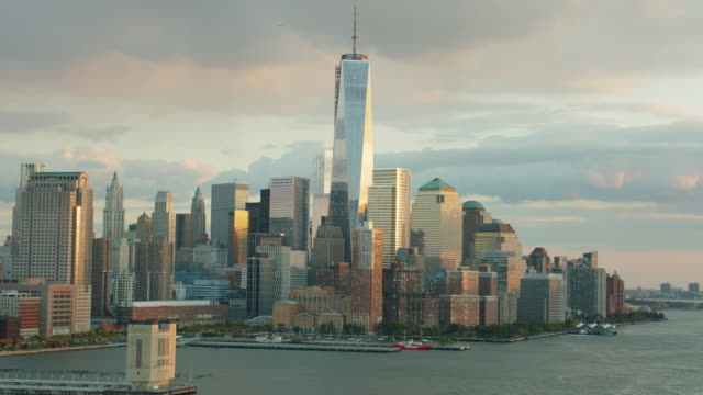 Aerial looking south over the Hudson River at the financial district and Word trade center at the end of the day