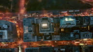 Aerial looking straight down at Upper Manhattan going into Central Park at night, NYC