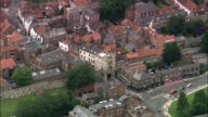 Aerial medium shot Roman city walls and gate in city of York / long shot pull out to view of York Minster / England