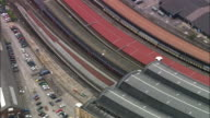 Aerial medium shot zoom out wide shot Great North Eastern Railway (GNER) train pulling into York Station / York, England