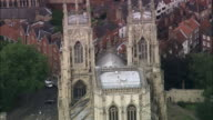 Aerial medium shot zoom out wide shot York Minster and surrounding buildings / York, England