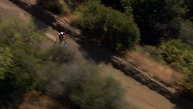 Aerial TS HA of mountain bike cyclist / Topanga State Canyon, California, United States