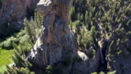 Aerial moving up rock tower
