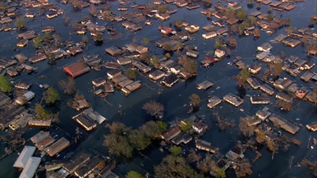 Aerial neighborhood of houses submerged in water / Louisiana