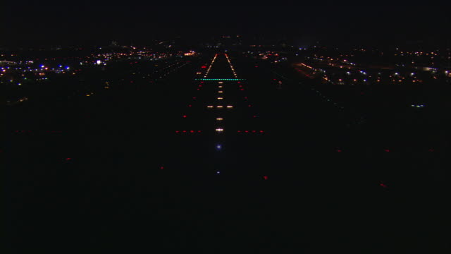 Aerial, night, Van Nuys Airport, airplane POV landing with runway lights / San Fernando Valley, California, United States