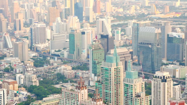 Aerial of Bangkok Downtown Skylines time-lapse sunset zoom-out