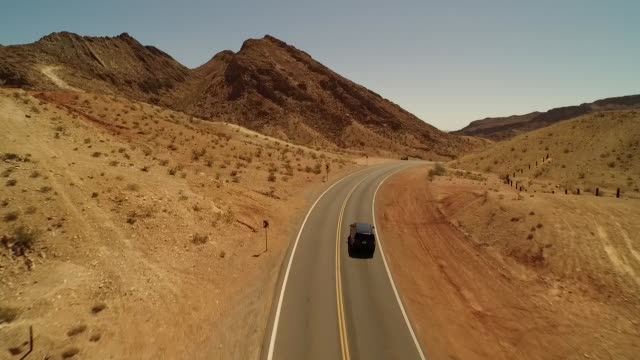Aerial of car driving off in desert