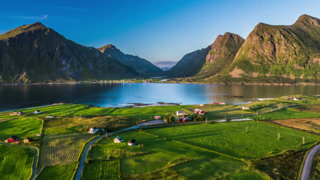 Aerial of fjord with traditional Norwegian village, Lofoten Islands Norway