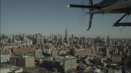aerial OF HELICOPTER FLYING OVER NEW YORK CITY. EMPIRE STATE BUIDLING VISIBLE IN BG.