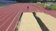Aerial of Paralympic athlete practicing triple jump