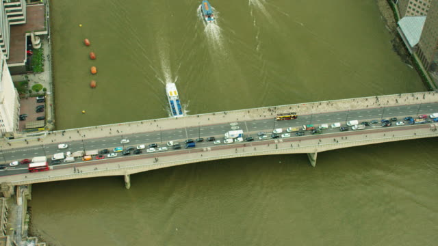 Aerial of people and boats on River Thames