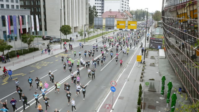 Aerial of runners at a marathon on a main street