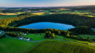 Aerial of rural landscape with volcanic Maar in Germany