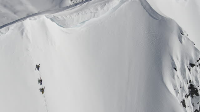 Aerial of ski mountaineers climbing Alaskan peak