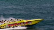 Aerial of South Pointe Beach, speed boat, South Beach, Miami FL