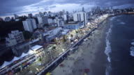 Aerial of the Carnabal de Salvador de Bahia with Lihgt house of Barra/ Circuito do Carnaval /orla /Farol da Barra /Salvador-Ba