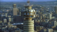 Aerial of the top of the Hillbrow tower moving further away to reveal the surrounding Johannesburg Central Business District
