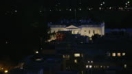 Aerial of The White House with lights on, evening Washington DC