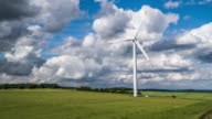 Aerial of Wind Turbine in green field