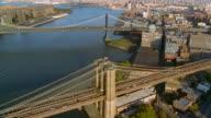 Aerial over Brooklyn and Manhattan Bridges in Brooklyn / New York City